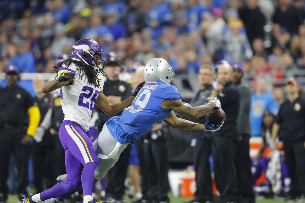Detroit Lions wide receiver Kenny Golladay (19) catches a pass as Minnesota Vikings cornerback Trae Waynes (26) defends during an NFL football game in Detroit, Thursday, Nov. 23, 2017. (AP Photo/P ...
