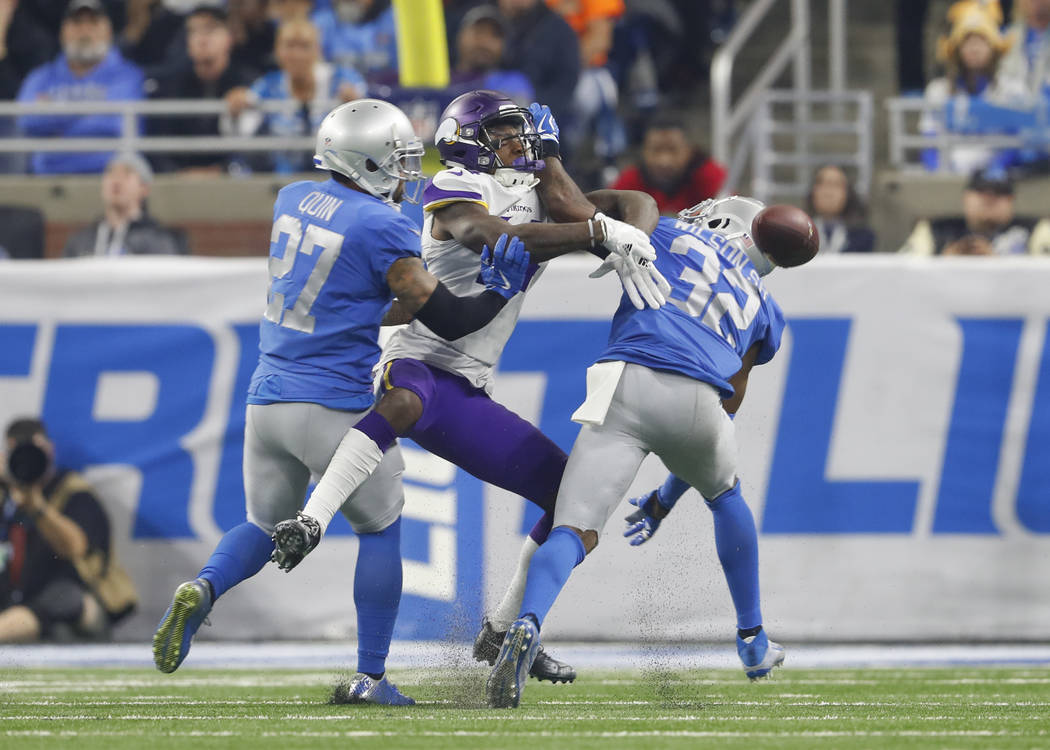 Detroit Lions strong safety Tavon Wilson (32) breaks up a pass intended for Minnesota Vikings wide receiver Stefon Diggs (14) during an NFL football game in Detroit, Thursday, Nov. 23, 2017. (AP P ...