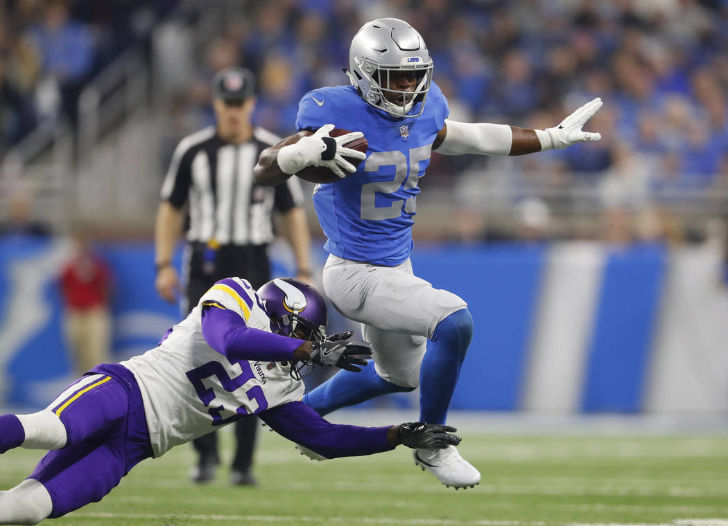 Detroit Lions running back Theo Riddick (25) eludes the tackle of Minnesota Vikings cornerback Terence Newman (23) during an NFL football game in Detroit, Thursday, Nov. 23, 2017. (AP Photo/Paul S ...