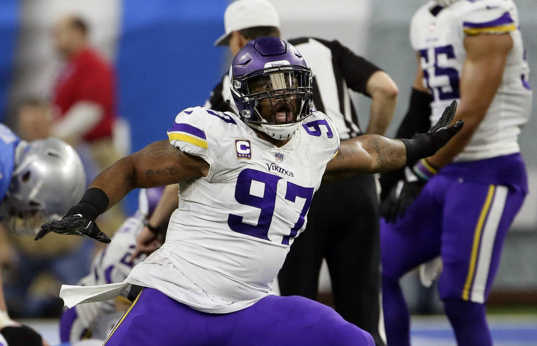 FILE - In this Nov. 23, 2017, file photo, Minnesota Vikings defensive end Everson Griffen (97) reacts after a play during the second half of an NFL football game against the Detroit Lions, in Detr ...