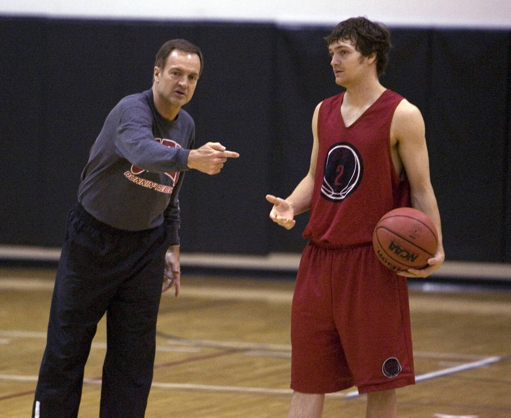 RJ FILE*** K.M. CANNON/REVIEW-JOURNAL UNLV Head Coach Lon Kruger gives instruction is son, point guard Kevin Kruger looks on during practice at Cox Pavilion Tuesday, March 20, 2007. UNLV is sche ...