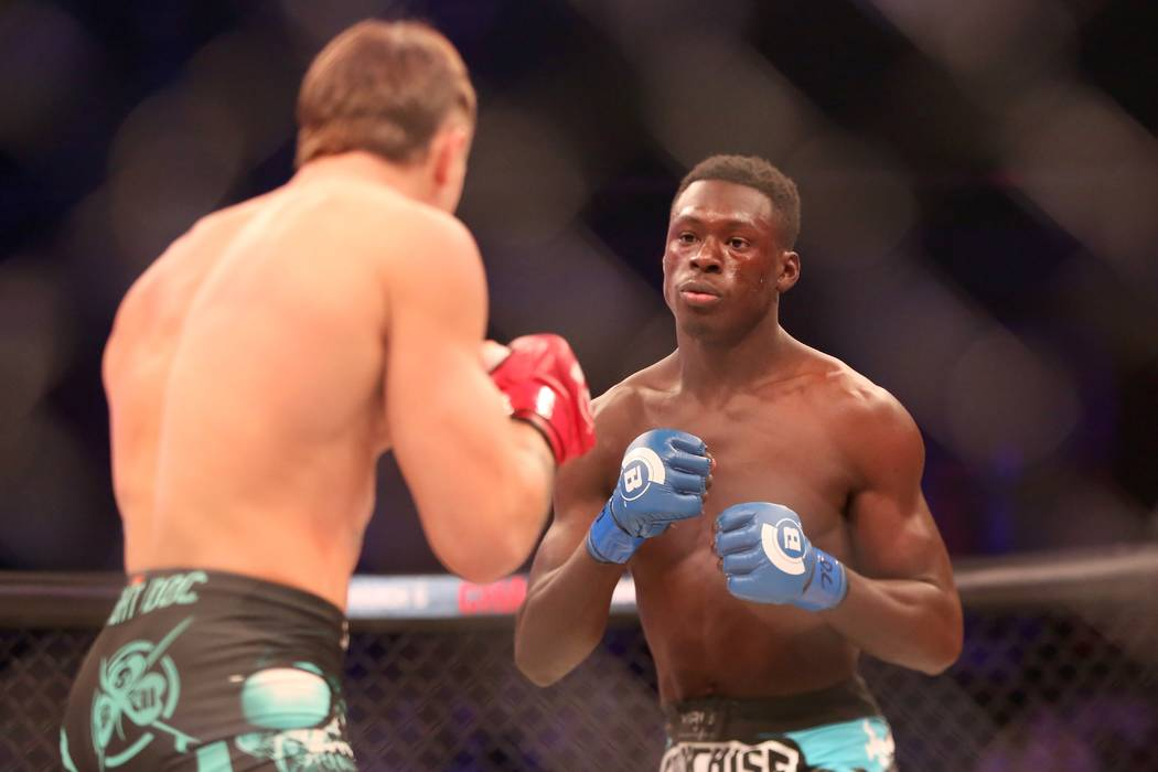 Curtis Millender in action against Brennan Ward during their ight at Bellator 134 on Friday, Feb. 27, 2015, in Uncasville, CT. Ward won the fight via rear naked choke submission. (AP Photo/Gregor ...