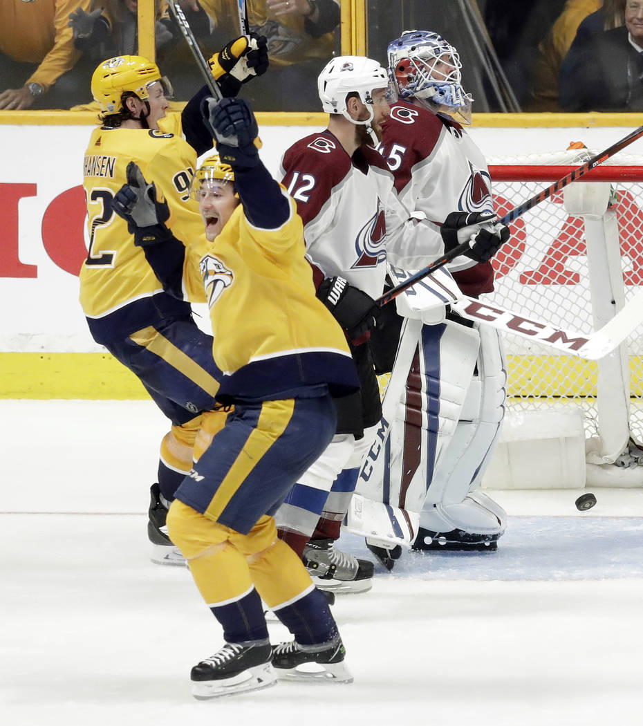 Nashville Predators left wing Filip Forsberg, front, of Sweden, celebrates after scoring the first of his two goals against Colorado Avalanche goaltender Jonathan Bernier (45), during the third pe ...