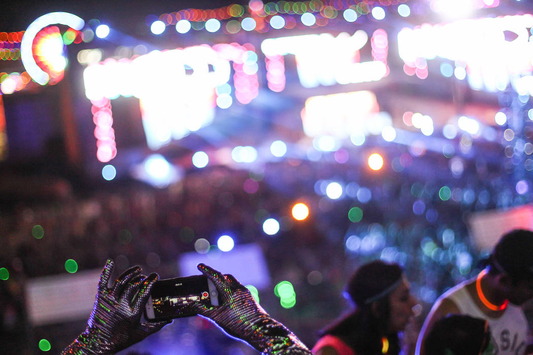 An attendee records video of the Cosmic Meadow stage at Electric Daisy Carnival at the Las Vegas Motor Speedway in Las Vegas on Sunday, June 21, 2015. (Chase Stevens/Las Vegas Review-Journal) Foll ...