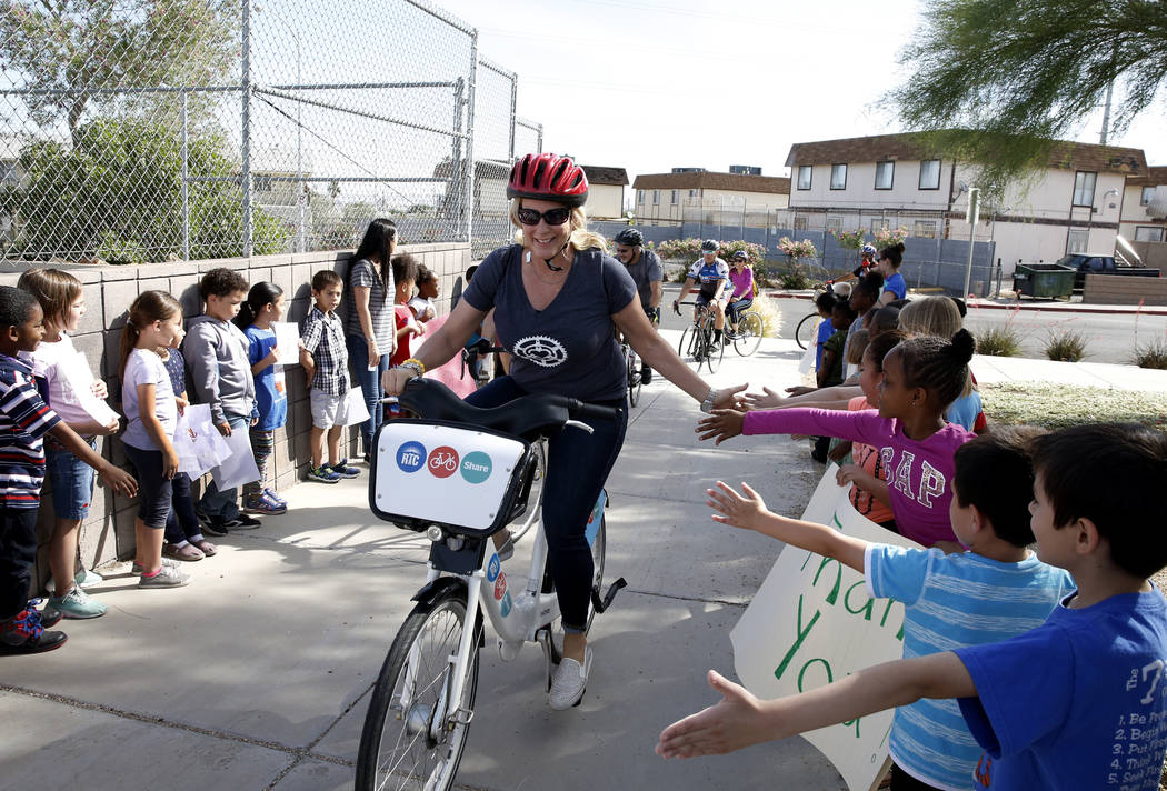 """Students at Robert L. Taylor Elementary School greet Traci Traasdahl as she delivers books to their school during the eighth annual """"Ride for Reading"""" event on Friday, May 11, 2018, ..."""