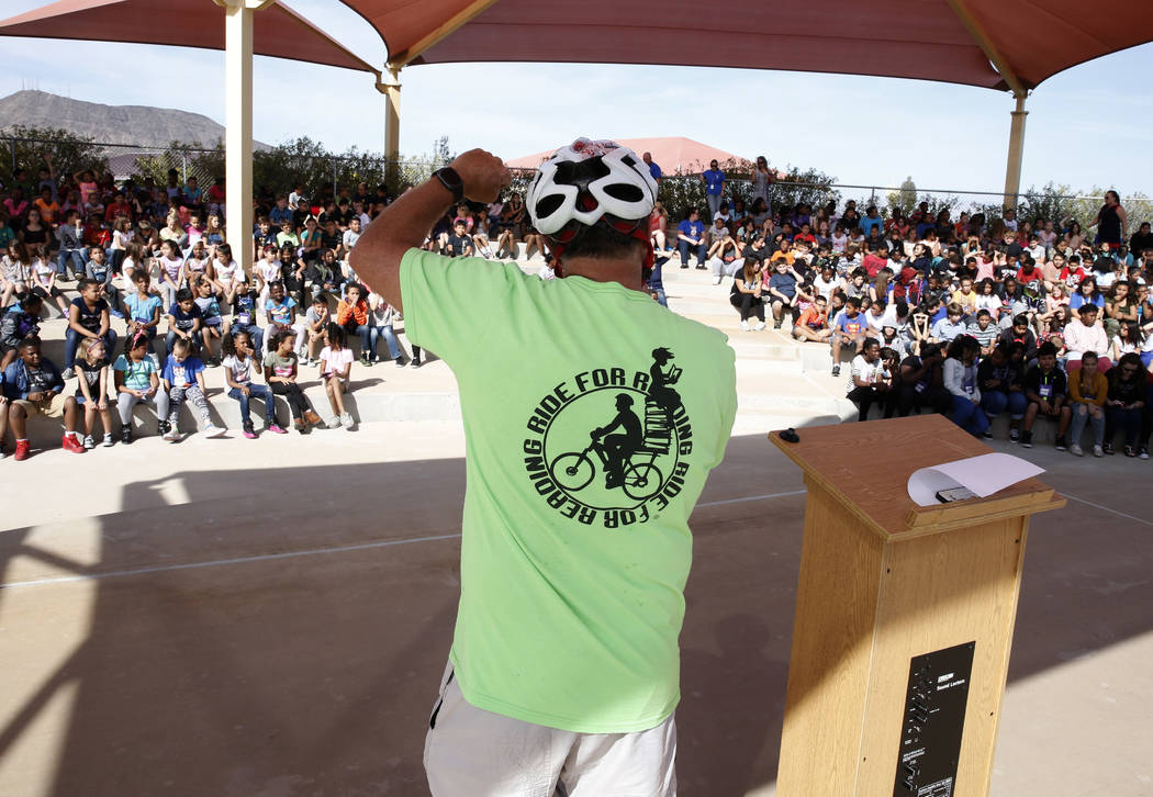 Ron Floth, Bicycle Outreach coordinator at Regional Transportation Commission of Southern Nevada, speaks to Robert L. Taylor Elementary School students during the eighth annual ÒRide for Rea ...