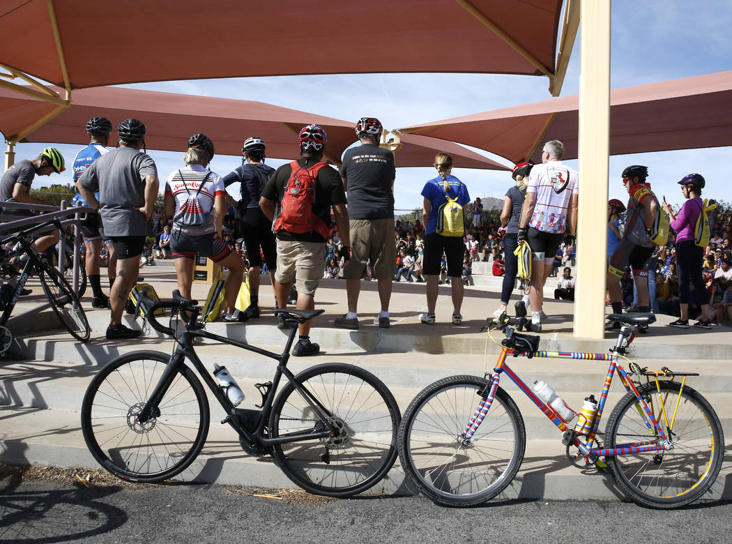"""Riders prepare to deliver books to Robert L. Taylor Elementary School students during the eighth annual """"Ride for Reading"""" event on Friday, May 11, 2018, in Henderson. Bizuayehu Tesf ..."""