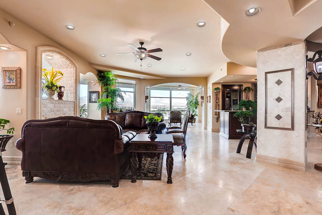 The living room leads to the kitchen. (Char Luxury Real Estate)