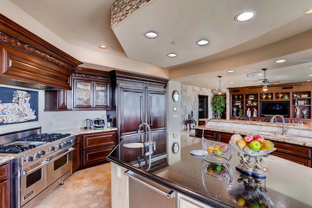 The kitchen has upgraded appliances. (Char Luxury Real Estate)