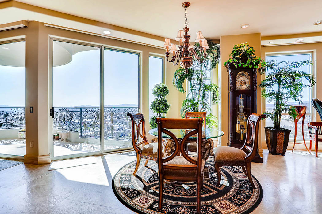 A breakfast nook opens to a balcony. (Char Luxury Real Estate)