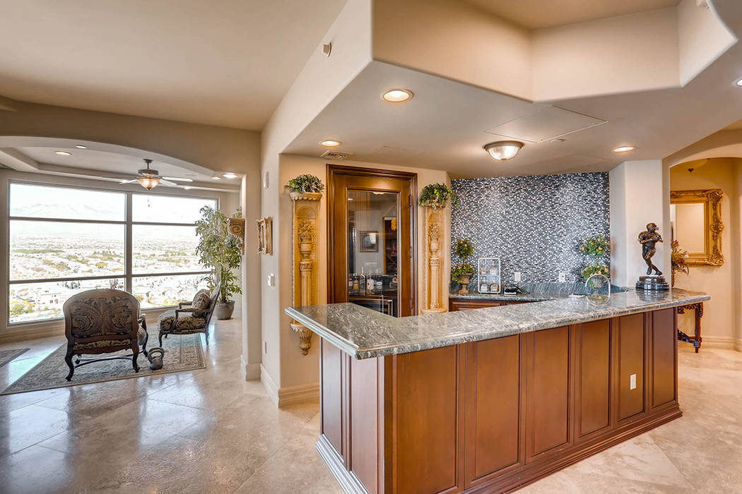 The home includes a bar.( Char Luxury Real Estate)