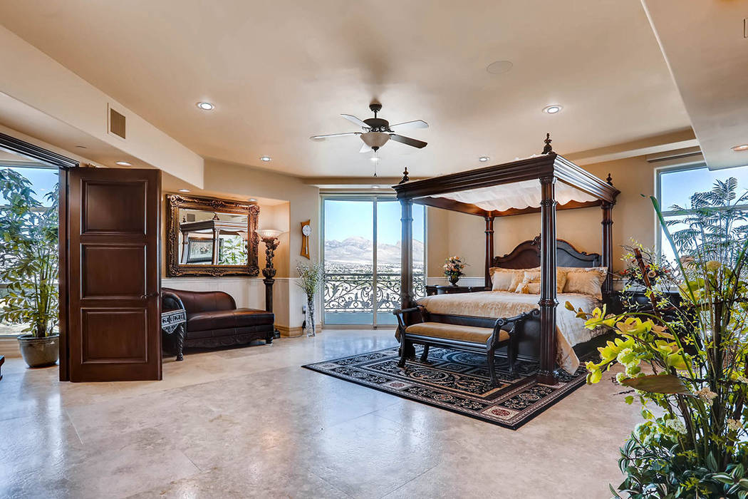 The master suite has a balcony. (Char Luxury Real Estate)