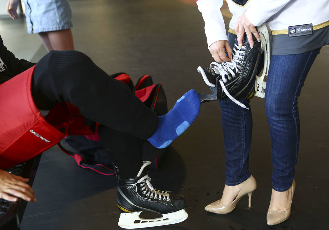 Stephanie Scott, right, helps her son, Cole Gould, 13, get ready before practice for the Vegas Jr. Golden Knights at City National Arena in Las Vegas on Thursday, May 10, 2018. Chase Stevens Las V ...