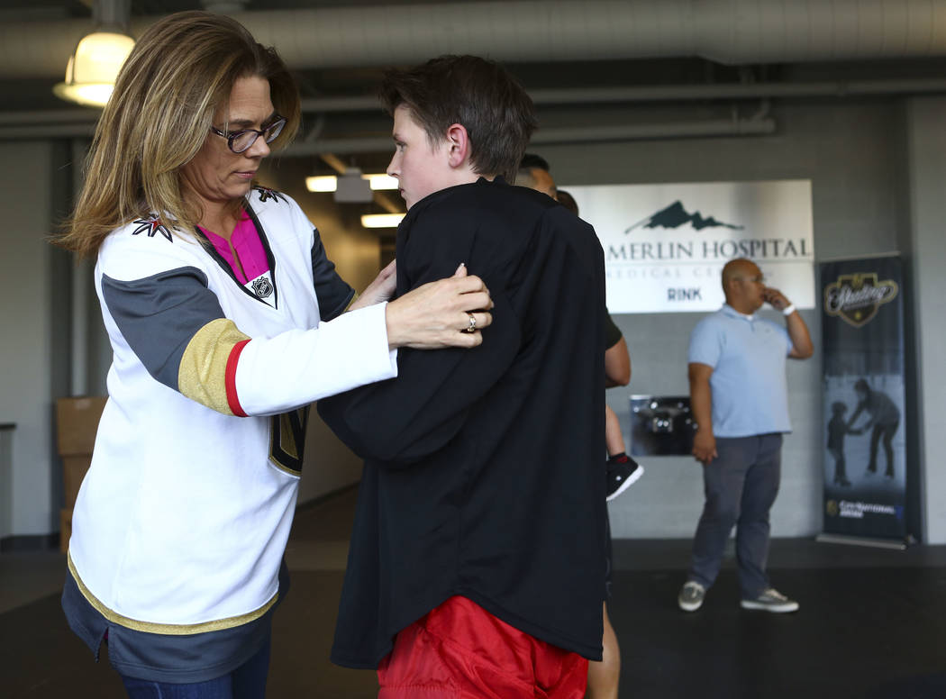 Stephanie Scott, left, helps her son, Cole Gould, 13, get ready before practice for the Vegas Jr. Golden Knights at City National Arena in Las Vegas on Thursday, May 10, 2018. Chase Stevens Las Ve ...