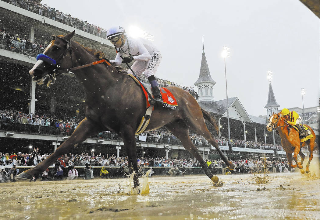 Mike Smith rides Justify to victory during the 144th running of the Kentucky Derby. (AP Photo/Morry Gash)