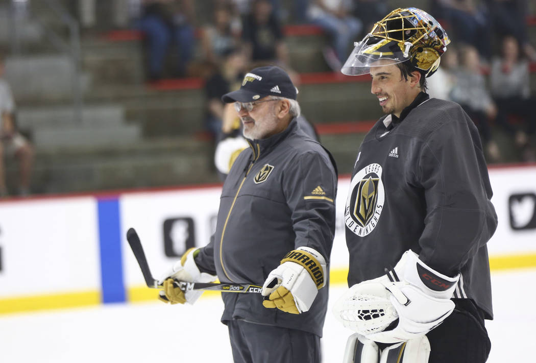 Golden Knights goaltending coach David Prior, left, talks with goaltender Marc-Andre Fleury during practice at City National Arena in Las Vegas on Thursday, May 10, 2018. Chase Stevens Las Vegas R ...