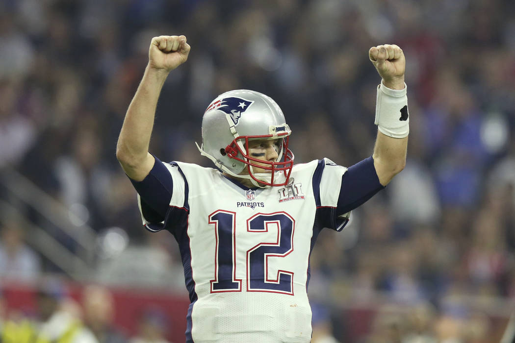 FILE - In this Feb. 5, 2017, file photo, New England Patriots quarterback Tom Brady celebrates a touchdown against the Atlanta Falcons during Super Bowl 51 in Houston. Tom Brady's missing jersey f ...