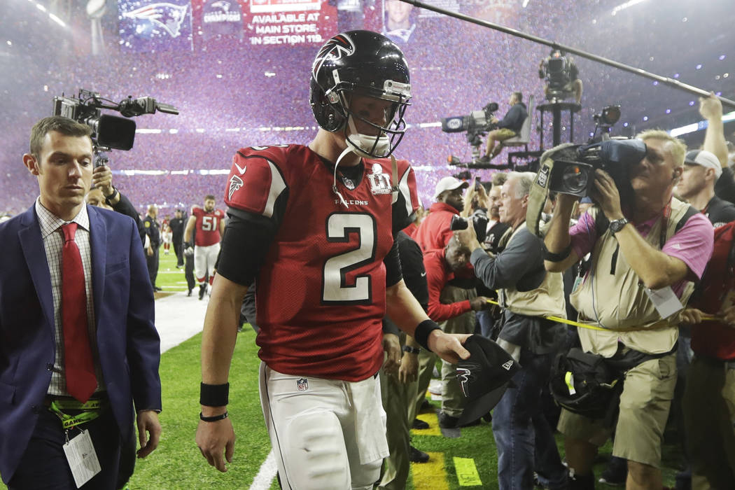 Atlanta Falcons' Matt Ryan leaves the field after their overtime loss to the New England Patriots in the NFL Super Bowl 51 football game Sunday, Feb. 5, 2017, in Houston. (AP Photo/Tony Gutierrez)