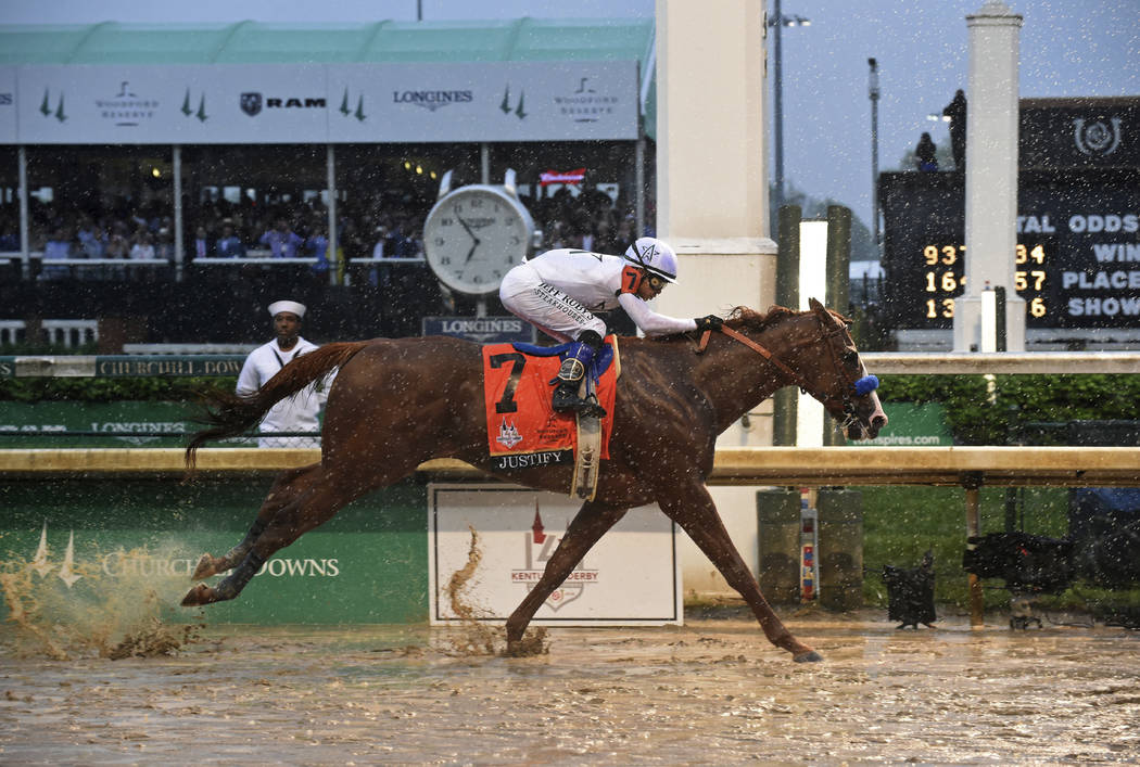 IMAGE DISTRIBUTED FOR LONGINES - Justify, ridden by jockey Mike Smith, wins the 144th Kentucky Derby, the wettest in history, on Saturday, May 5, 2018, at Churchill Downs in Louisville, Ky. Longin ...