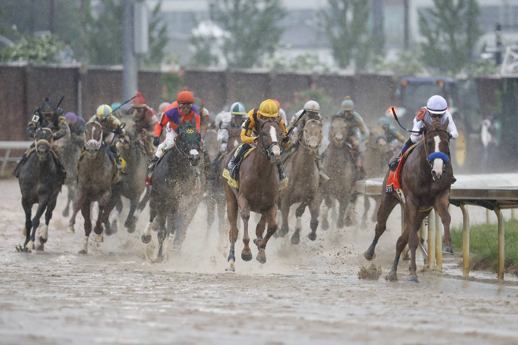 Mike Smith, right, rides Justify through the fourth turn and unto victory during the 144th running of the Kentucky Derby horse race at Churchill Downs Saturday, May 5, 2018, in Louisville, Ky. (AP ...