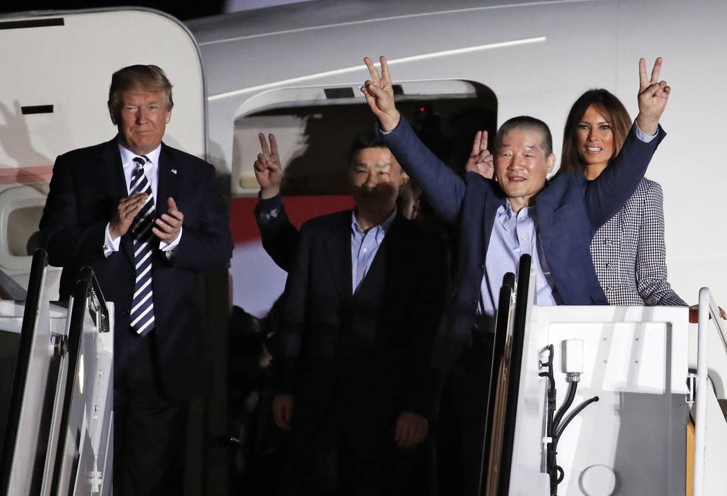 President Donald Trump and first lady Melania Trump greet former North Korean detainees Kim Dong Chul, second right, Tony Kim, center, and Kim Hak Song, behind Tony Kim, upon their arrival, Thursd ...