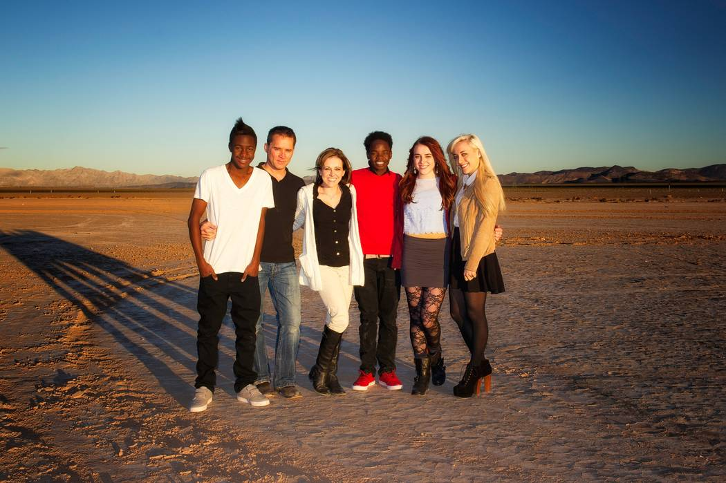 The Rice family poses for a photo in 2013 at a dry lake bed outside Las Vegas. From left: Reagan Rice, Michael Rice, Cassie Rice, Becca Rice, Lauren Rice and Taylor Rice. Photo courtesy of Cassie ...