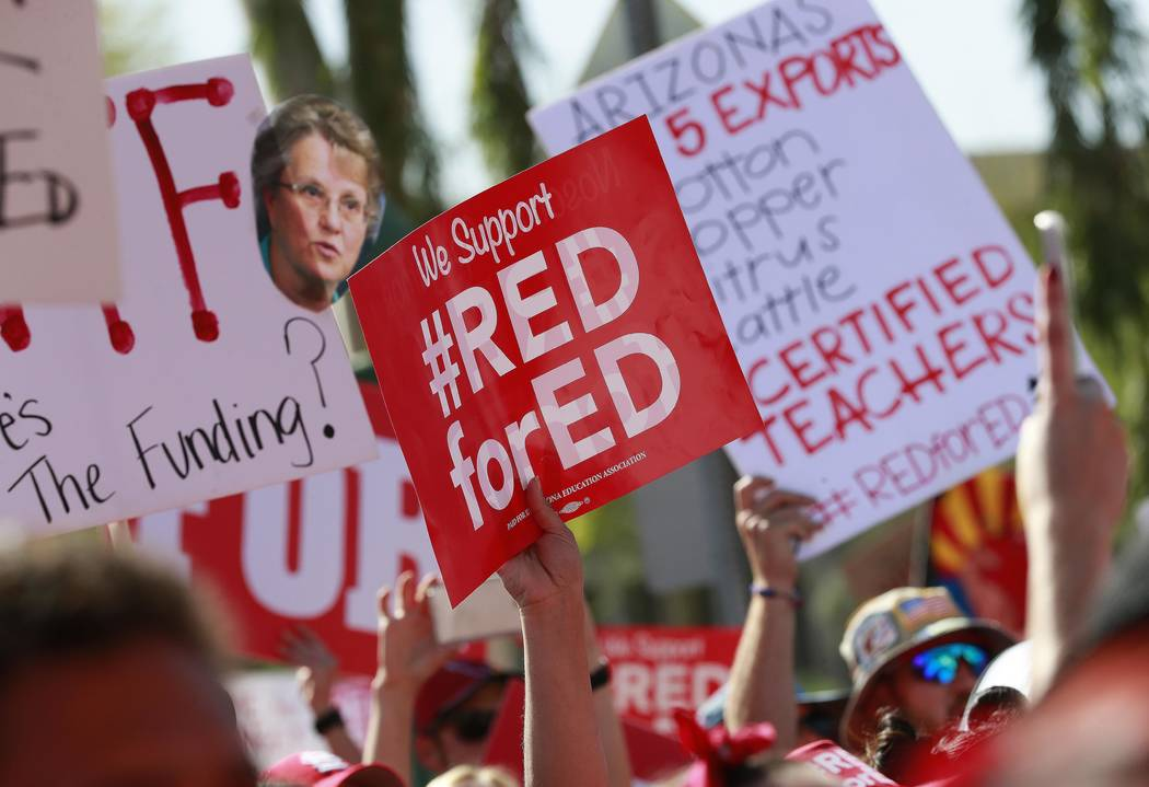 Teachers rally outside the Capitol, Friday, April 27, 2018, in Phoenix, on their second day of walkouts. Teachers in Arizona and Colorado walked out of their classes over low salaries keeping hund ...