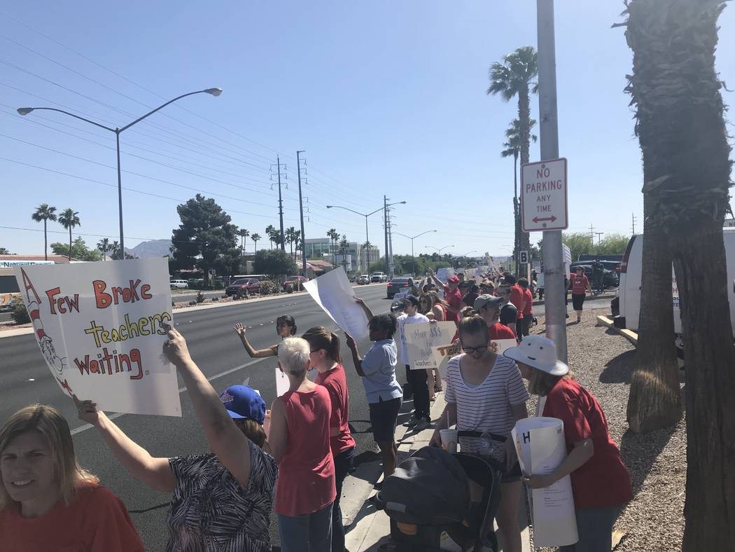 Educators rally outside the Edward Greer Education Center in Las Vegas to fight for pay raises on Saturday, April 28, just before community meetings for the six Clark County School District superi ...