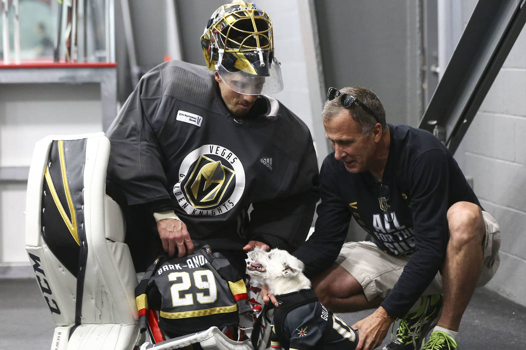 Golden Knights goaltender Marc-Andre Fleury (29) meets Bark Andre-Furry, a Jack Russell terrier, and his owner, Rick Williams, after practice at City National Arena in Las Vegas on Thursday, May 1 ...