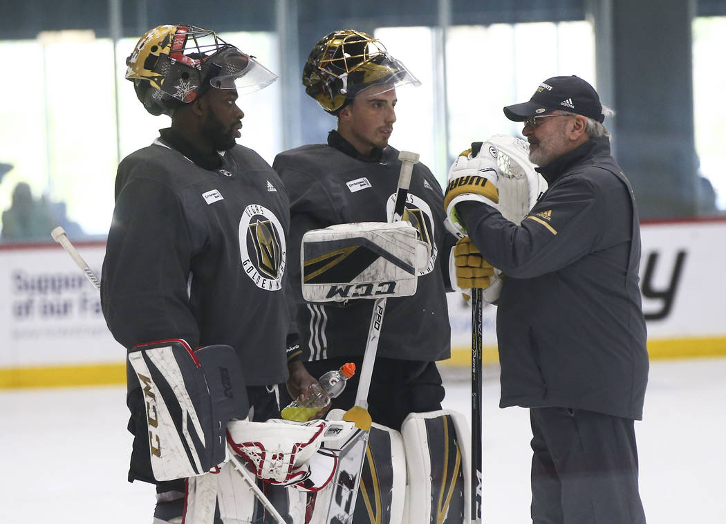 Golden Knights goaltending coach David Prior, right, talks with goaltenders Malcolm Subban, left, and Marc-Andre Fleury during practice at City National Arena in Las Vegas on Thursday, May 10, 201 ...