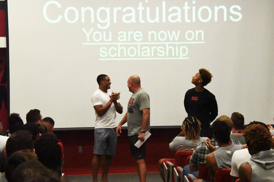UNLV football coach Tony Sanchez awarding scholarships to walk-on defensive backs Jocquez Kalili and Ty'Jason Roberts in a team meeting Thursday, May 10, 2018. (Courtesy/UNLV Athletics)