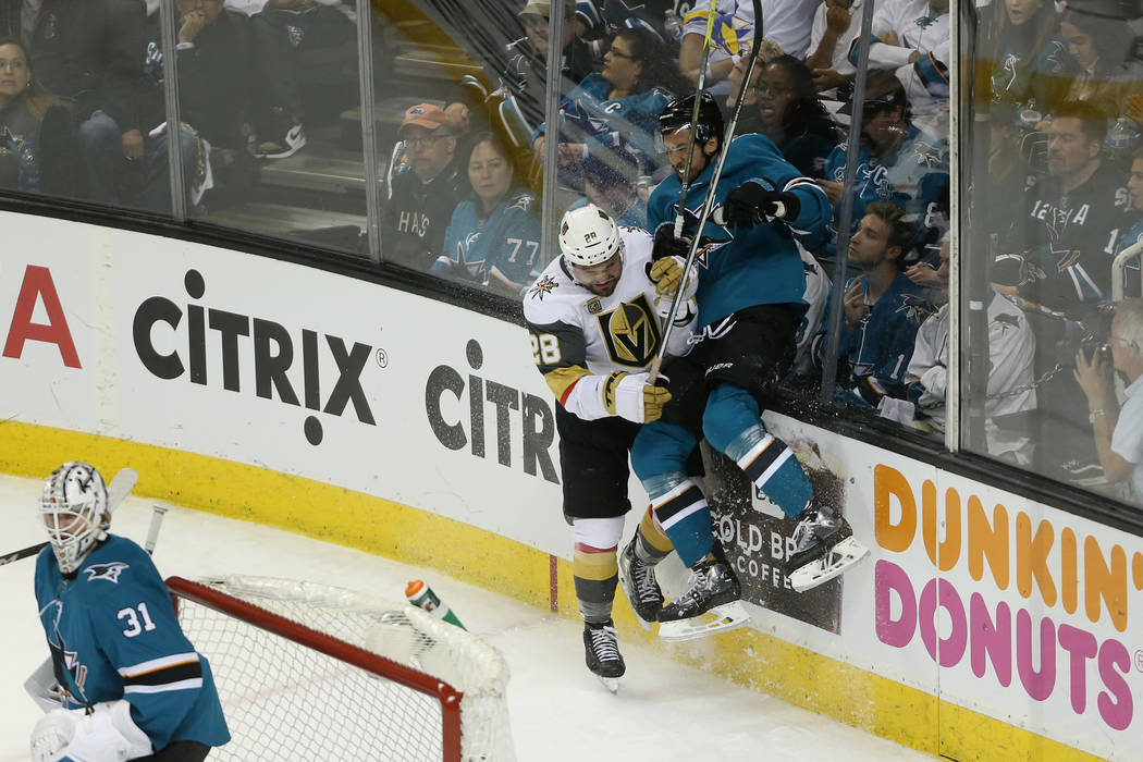 Vegas Golden Knights left wing William Carrier (28) slams San Jose Sharks defenseman Brenden Dillon (4) against the glass during the third period in Game 3 of an NHL hockey second-round playoff se ...
