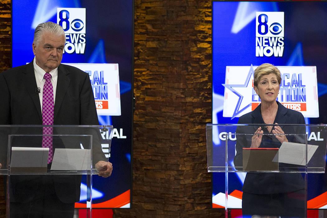 Democratic gubernatorial candidates Steve Sisolak, left, and Chris Giunchigliani debate on KLAS-TV 8 in Las Vegas, Monday, May 21, 2018. (Richard Brian/Las Vegas Review-Journal via AP)