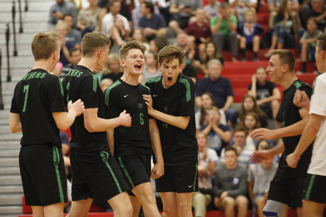 The Palo Verde High School volleyball team reacts after scoring against Centennial High School in the Sunset Region boys semifinal against at Arbor View High School in Las Vegas, Thursday, May 10, ...