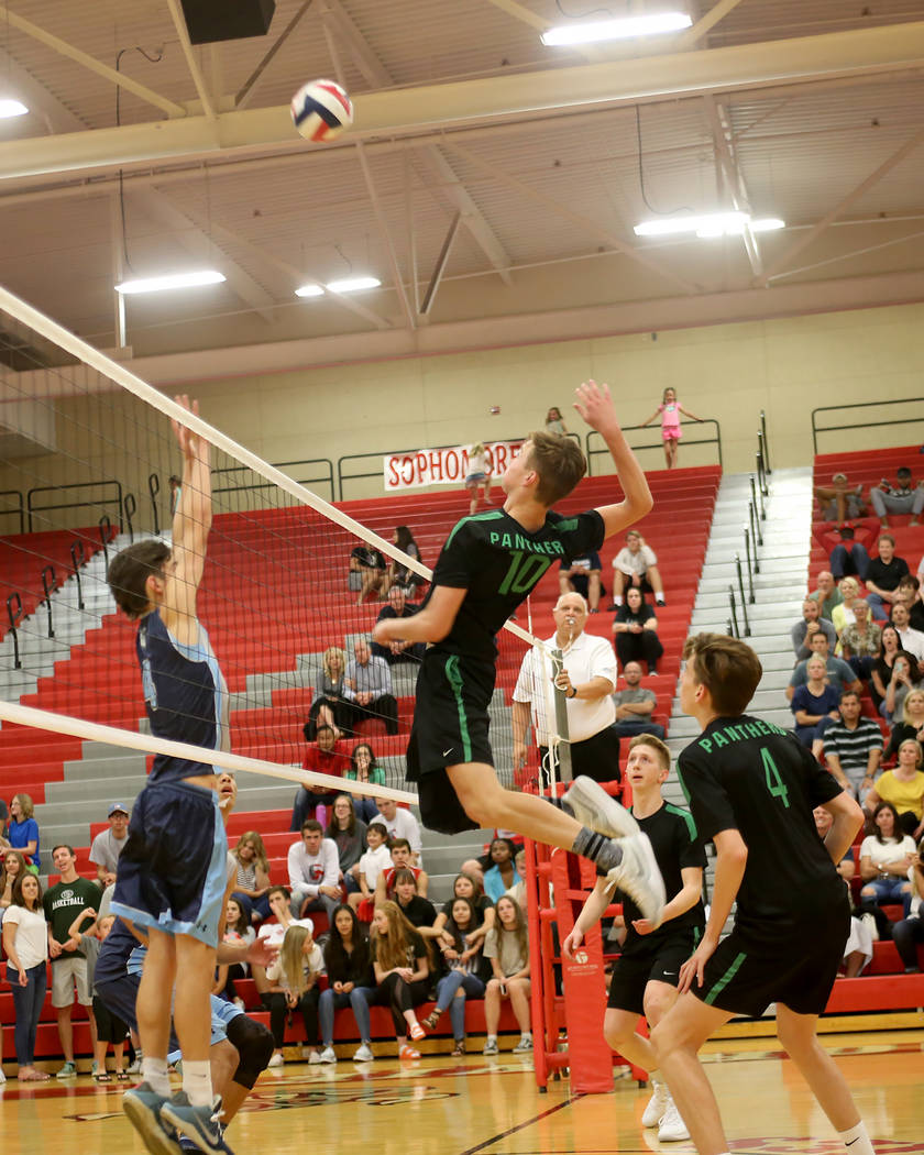 Palo Verde High School's Jared Brady (10) spikes the ball against Centennial High School's Sam Durkin (4) in the Sunset Region boys semifinal at Arbor View High School in Las Vegas, Thursday, May ...