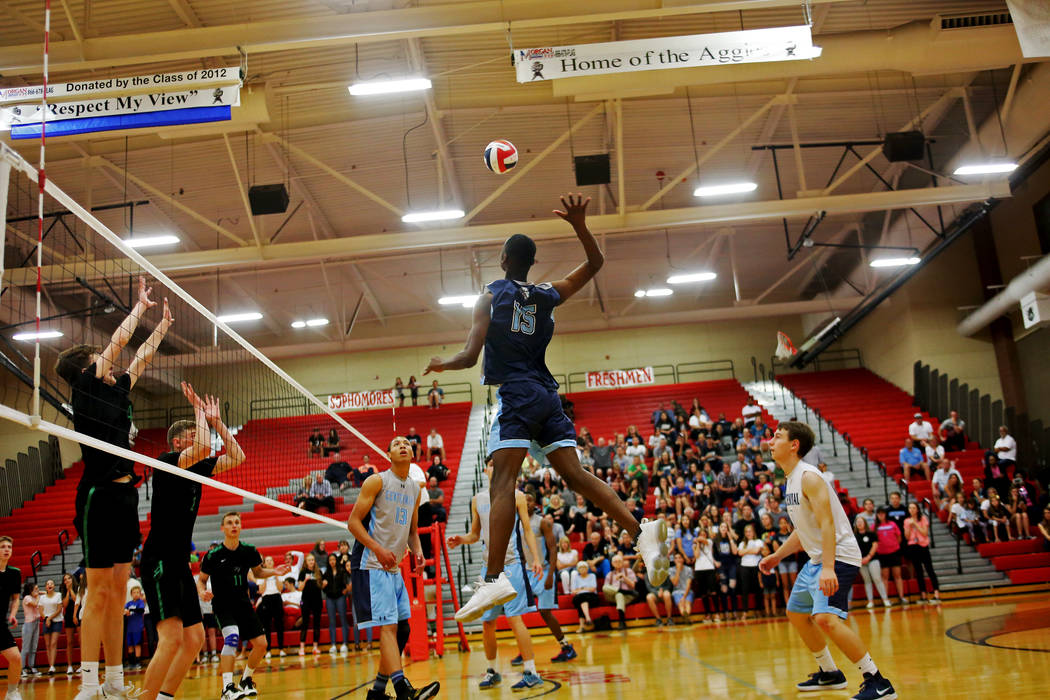 Centennial High School's Nhamani Brown (15) spikes the ball as teammate Teon Taylor (13) looks on in the Sunset Region boys semifinal against Palo Verde High School at Arbor View High School in La ...