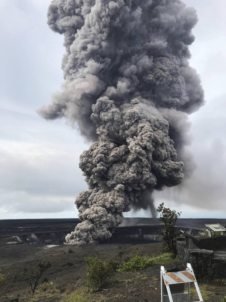 In this Wednesday, May 9, 2018 photo, an ash column rises from the crater at the summit of Kilauea volcano at Volcanoes National Park, Hawaii. Scientists said Wednesday the risks of an explosive s ...