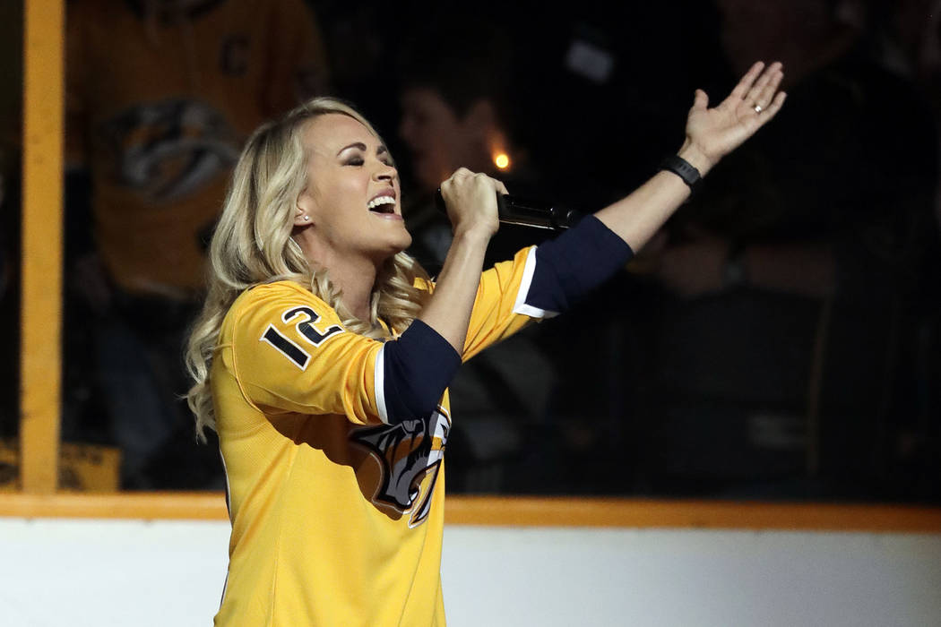 Carrie Underwood sings the national anthem before Game 2 of an NHL hockey second-round playoff series between the Nashville Predators and the Winnipeg Jets Monday, April 30, 2018, in Nashville, Te ...