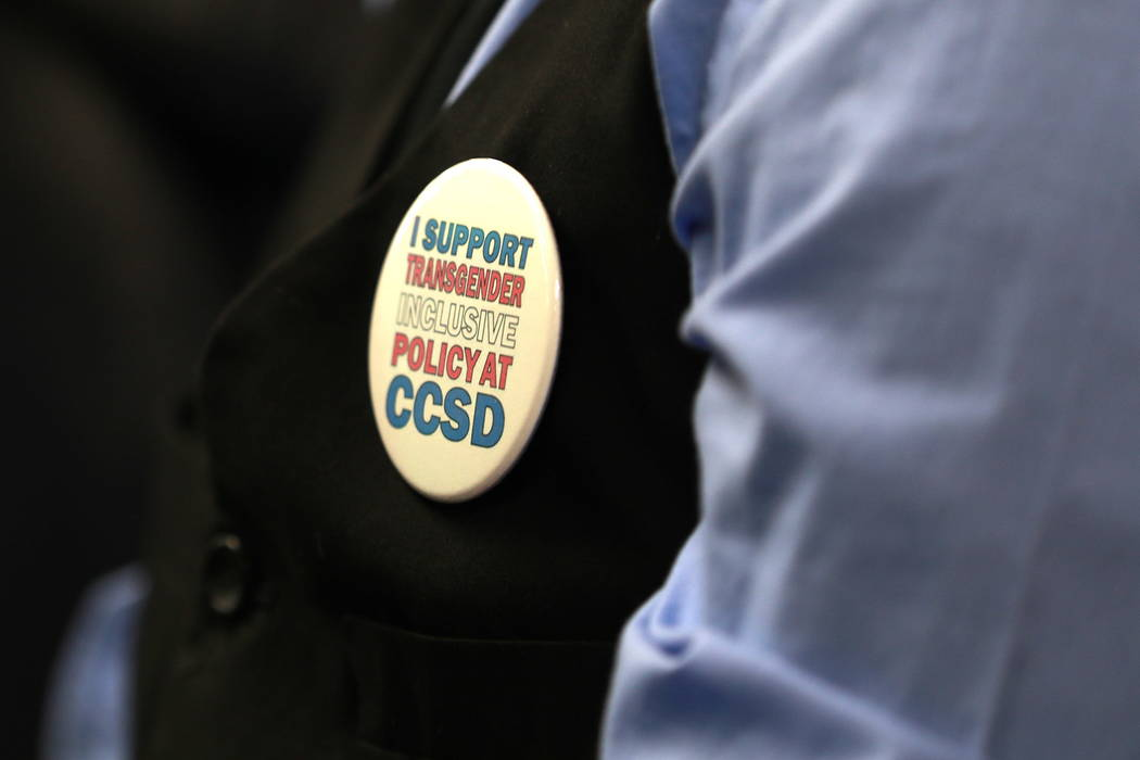 An attendee wears a pin in support of gender-diverse policy during a Clark County School Board meeting, which ended with the board pulling the controversial policy from the agenda, at the Edward ...