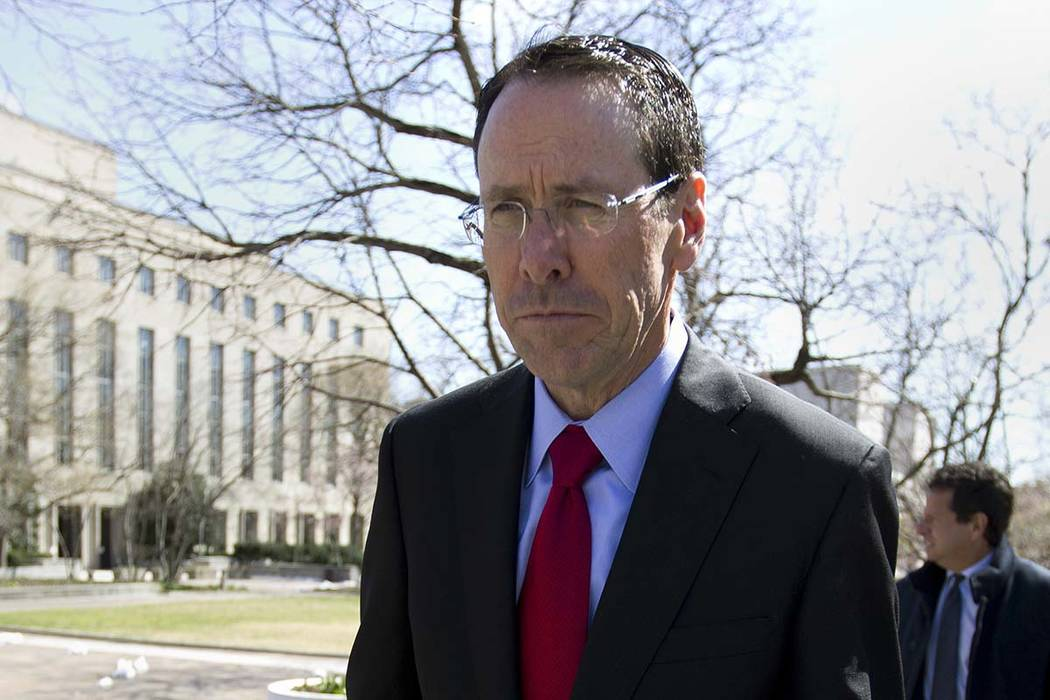 "AT&T CEO Randall Stephenson leaves the federal courthouse in Washington on March 22. Stephenson says the company made a ""big mistake"" in hiring President Donald Trump's attorney Michael Coh"