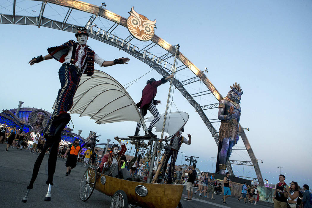 Costumed performers make their way past the entrance ofKinetic Field on the first night of Electric Daisy Carnival at Las Vegas Motor Speedway on Friday, June 16, 2017 in Las Vegas. Bridget Bennet ...