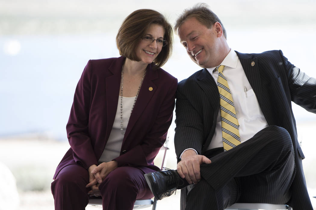 U.S. Sen. Catherine Cortez Masto, D-Nev., left, and U.S. Sen. Dean Heller, R-Nev., attend the commissioning and blessing ceremony for the Moapa Southern Paiute Solar Project at the Moapa Indian Re ...