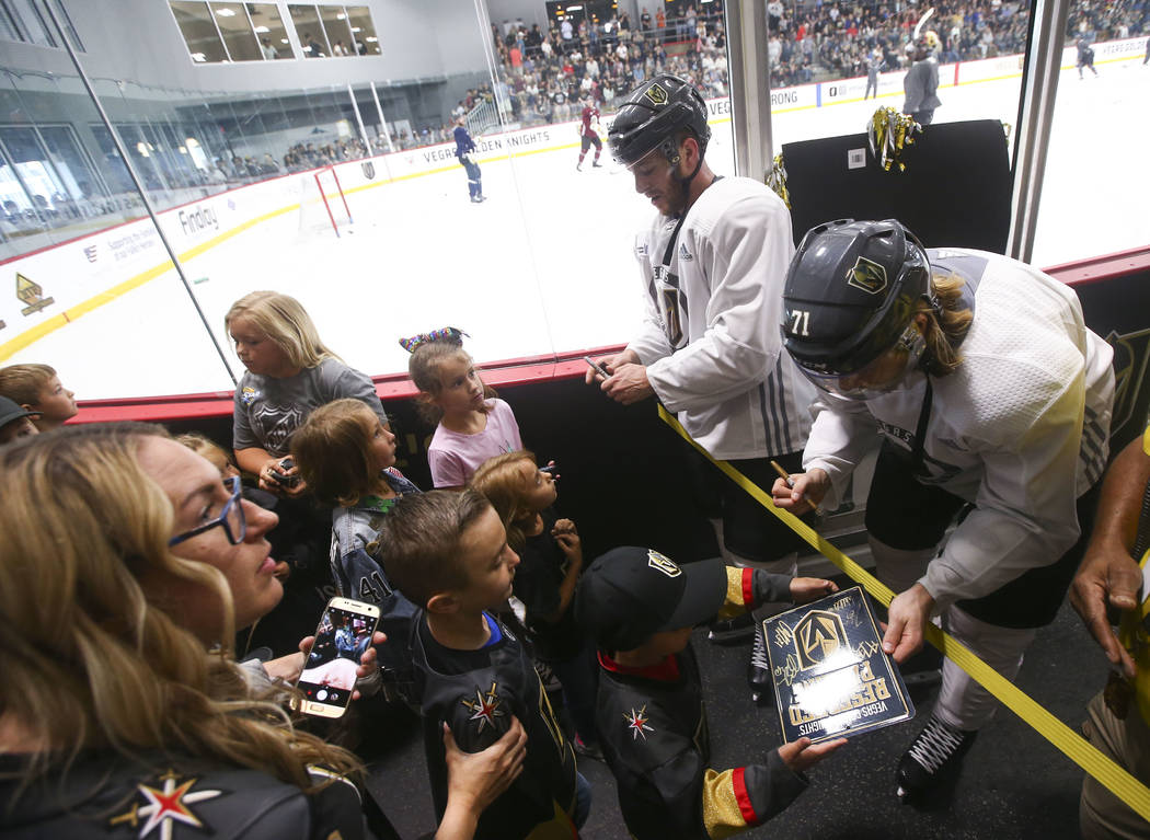 Golden Knights players Jonathan Marchessault, center right, and William Karlsson sign autographs for young fans during practice at City National Arena in Las Vegas on Thursday, May 10, 2018. Chase ...