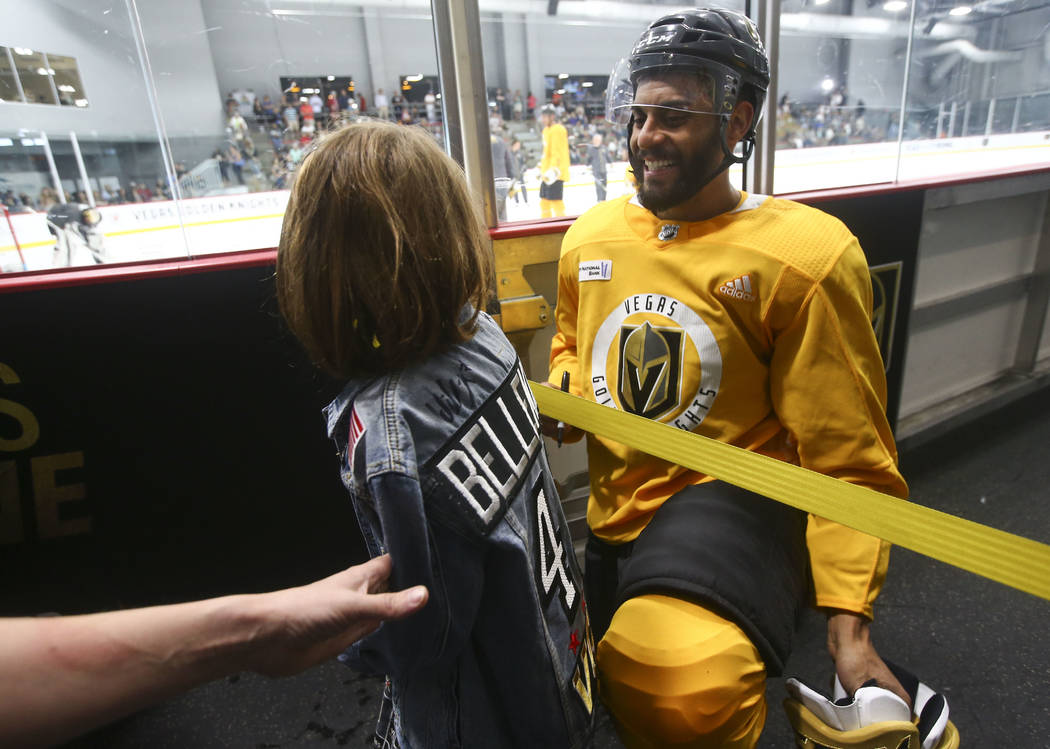 Golden Knights left wing Pierre-Edouard Bellemare (41) greets a young fan during practice at City National Arena in Las Vegas on Thursday, May 10, 2018. Chase Stevens Las Vegas Review-Journal @css ...