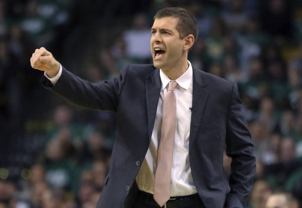 Boston Celtics head coach Brad Stevens instructs his players in the first quarter against the Philadelphia 76ers in Game 1 of an NBA basketball second-round playoff series, Monday, April 30, 2018, ...