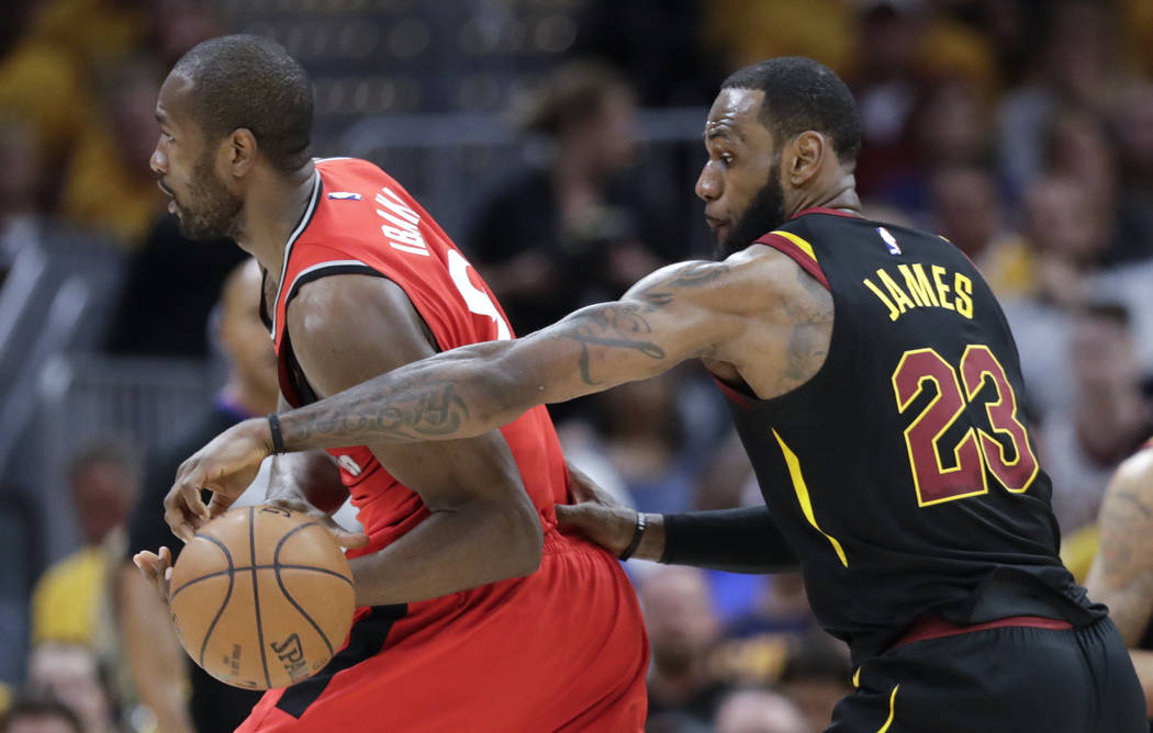 Cleveland Cavaliers' LeBron James (23) strips the ball from Toronto Raptors' Serge Ibaka in the first half of Game 4 of an NBA basketball second-round playoff series, Monday, May 7, 2018, in Cleve ...