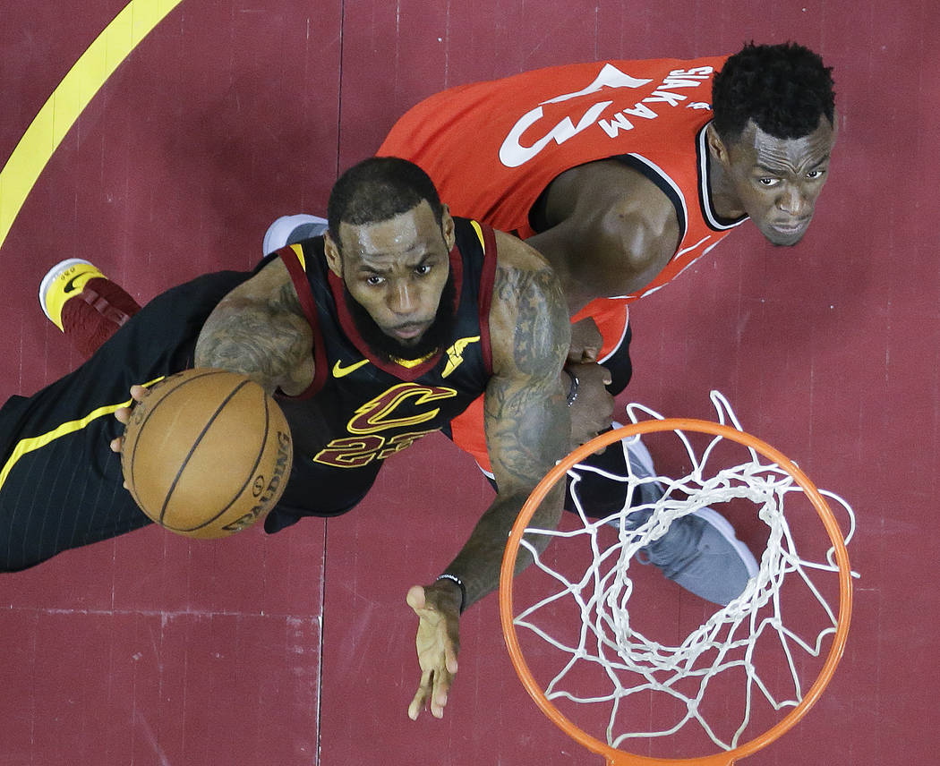 Cleveland Cavaliers' LeBron James shoots against Toronto Raptors' Pascal Siakam (43), from Cameroon, in the first half of Game 4 of an NBA basketball second-round playoff series, Monday, May 7, 20 ...