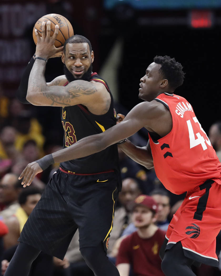 Cleveland Cavaliers' LeBron James looks to drive on Toronto Raptors' Pascal Siakam (43), from Cameroon, in the second half of Game 4 of an NBA basketball second-round playoff series, Monday, May 7 ...