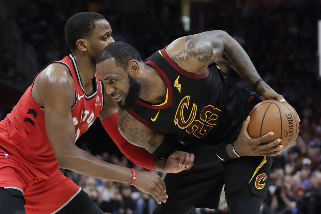 Cleveland Cavaliers' LeBron James (23) looks to drive on Toronto Raptors' CJ Miles in the first half of Game 3 of an NBA basketball second-round playoff series, Saturday, May 5, 2018, in Cleveland ...