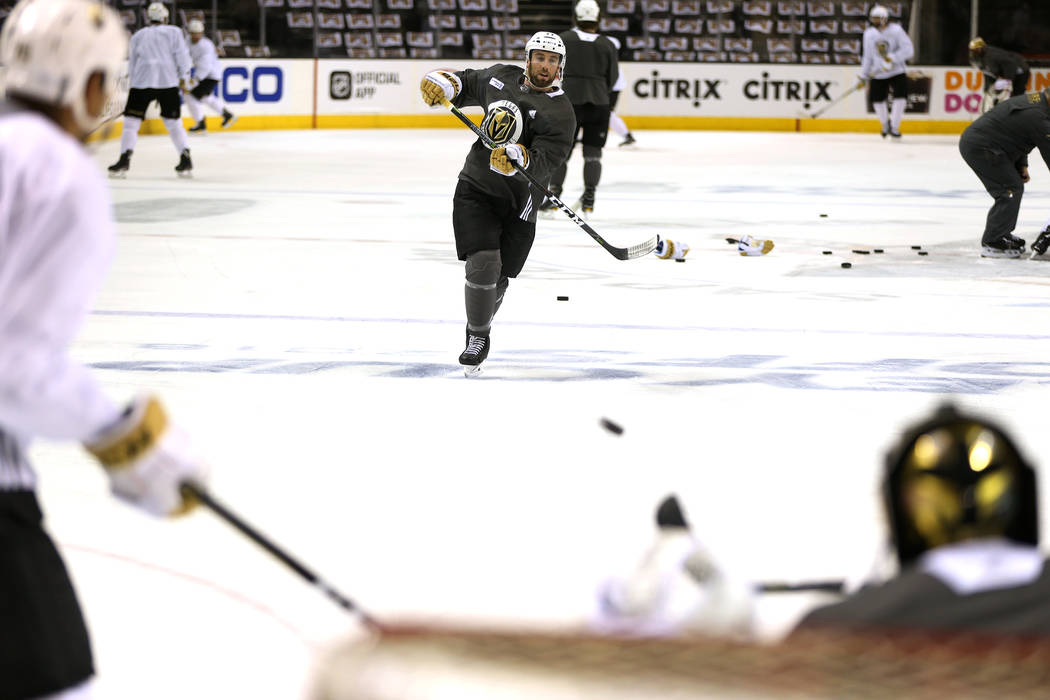 Vegas Golden Knights defenseman Brad Hunt (77) takes a shot at goaltender Marc-Andre Fleury (29) during practice before Game 3 of an NHL hockey second-round playoff series against the San Jose Sha ...
